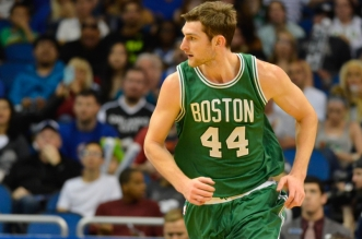 Mar 8, 2015; Orlando, FL, USA; Boston Celtics center Tyler Zeller (44) runs down the court during the  second half against the Orlando Magic at Amway Center. Orlando Magic defeated Boston Celtics 103-98. Mandatory Credit: Tommy Gilligan-USA TODAY Sports