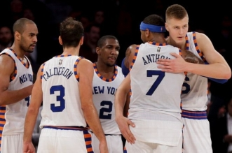 Carmelo Anthony (7) hugs New York Knicks forward Kristaps Porzingis (6) as they huddle with guard Arron Afflalo (4), guard Jose Calderon (3) and guard Langston Galloway (2)