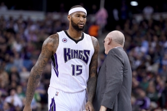 SACRAMENTO, CA - FEBRUARY 20:  DeMarcus Cousins #15 of the Sacramento Kings walks back to the bench past head coach George Karl after Cousins was called for a technical foul against the Boston Celtics in the first quarter at Sleep Train Arena on February 20, 2015 in Sacramento, California. NOTE TO USER: User expressly acknowledges and agrees that, by downloading and or using this photograph, User is consenting to the terms and conditions of the Getty Images License Agreement.  (Photo by Thearon W. Henderson/Getty Images)