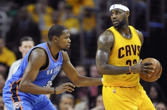 Jan 25, 2015; Cleveland, OH, USA; Oklahoma City Thunder forward Kevin Durant (35) defends Cleveland Cavaliers forward LeBron James (23) in the second quarter at Quicken Loans Arena. Mandatory Credit: David Richard-USA TODAY Sports