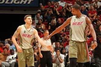 MIAMI, FL - NOVEMBER 12:  Tyler Johnson #8 of the Miami Heat and Chris Bosh #1 of the Miami Heat shake hands during the game against the Utah Jazz on November 12, 2015 at American Airlines Arena in Miami, Florida. NOTE TO USER: User expressly acknowledges and agrees that, by downloading and or using this Photograph, user is consenting to the terms and conditions of the Getty Images License Agreement. Mandatory Copyright Notice: Copyright 2015 NBAE (Photo by Issac Baldizon/NBAE via Getty Images)