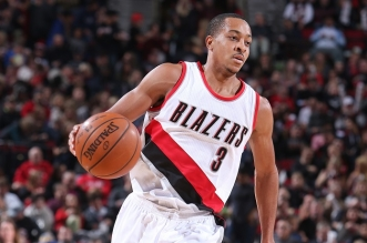 PORTLAND, OR - DECEMBER 30: C.J. McCollum #3 of the Portland Trail Blazers handles the ball against the Denver Nuggets on December 30, 2015 at the Moda Center in Portland, Oregon. NOTE TO USER: User expressly acknowledges and agrees that, by downloading and or using this Photograph, user is consenting to the terms and conditions of the Getty Images License Agreement. Mandatory Copyright Notice: Copyright 2015 NBAE (Photo by Sam Forencich/NBAE via Getty Images)