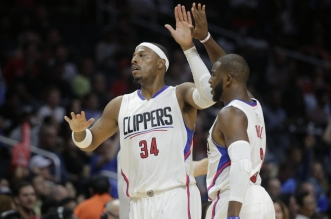 Los Angeles Clippers' Paul Pierce, left, high-fives teammate Chris Paul after making a three-point basket during the second half of an NBA preseason basketball game against the Denver Nuggets, Friday, Oct. 2, 2015, in Los Angeles. The Clippers won 103-96. (AP Photo/Jae C. Hong)