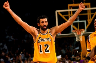 INGLEWOOD, CA - MAY 4:  Vlade Divac #12 of the Los Angeles Lakers celebrates in Game Four of the Western Conference Quarterfinals against the Seattle SuperSonics during the 1995 NBA Playoffs at the Great Wester Forum on May 4, 1995 in Inglewood, Califorinia.  The Los Angeles Lakers defeated the Seattle Supersonics 114-110. NOTE TO USER: User expressly acknowledges and agrees that, by downloading and or using this photograph, User is consenting to the terms and conditions of the Getty Images License Agreement. Mandatory Copyright Notice: Copyright 1995 NBAE (Photo by Andrew D. Bernstein/NBAE via Getty Images)