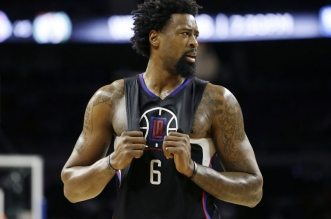 Los Angeles Clippers center DeAndre Jordan (6) looks towards the bench during the first half of an NBA basketball game against the Detroit Pistons, Monday, Dec. 14, 2015, in Auburn Hills, Mich. (AP Photo/Carlos Osorio)