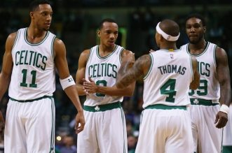 BOSTON, MA - FEBRUARY 25:  Isaiah Thomas #4 talks with Evan Turner #11, Avery Bradley #0, and Jae Crowder #99 of the Boston Celtics during the game against the New York Knicks at TD Garden on February 25, 2015 in Boston, Massachusetts. NOTE TO USER: User expressly acknowledges and agrees that, by downloading and or using this photograph, User is consenting to the terms and conditions of the Getty Images License Agreement.  (Photo by Maddie Meyer/Getty Images)