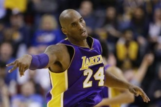Los Angeles Lakers forward Kobe Bryant (24) after hitting a shot against the Indiana Pacers during the second half of an NBA basketball game in Indianapolis, Monday, Feb. 8, 2016. The Pacers defeated the Lakers 89-87. (AP Photo/Michael Conroy)