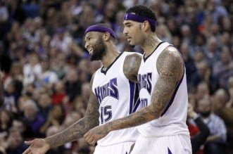 Jan 23, 2016; Sacramento, CA, USA; Sacramento Kings center DeMarcus Cousins (15) reacts next to center Willie Cauley-Stein (00) after making a shot while being fouled against the Indiana Pacers in the second quarter at Sleep Train Arena. Mandatory Credit: Cary Edmondson-USA TODAY Sports
