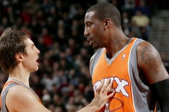 PORTLAND, OR - DECEMBER 18:  (L-R) Steve Nash #13 of the Phoenix Suns talks to teammate Amar'e Stoudemire #1 during the game against the Portland Trail Blazers on December 18, 2008 at the Rose Garden Arena in Portland, Oregon.  The Trail Blazers won 124-119.  NOTE TO USER:  User expressly acknowledges and agrees that, by downloading and or using this photograph, User is consenting to the terms and conditions of the Getty Images License Agreement. Mandatory Copyright Notice: Copyright 2008 NBAE  (Photo by Sam Forencich/NBAE via Getty Images)