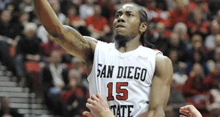 San Diego State's Kawhi Leonard (15) shoots over San Diego's Devin Ginty (3) during the first half of an NCAA college basketball game Saturday, Dec. 11, 2010, in San Diego. (AP Photo/Denis Poroy)