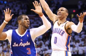 OKLAHOMA CITY, OKLAHOMA, MAY 13, 2014- Clippers Chris Paul fouls Thunders Russell Westbrook on a three-pointer with seconds left in the 4th quarter in Game 5 of the NBA Western Conference playoffs in Oklahoma City Tuesday. (Wally Skalij/Los Angeles Times)