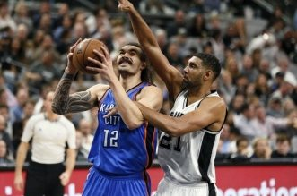 Apr 12, 2016; San Antonio, TX, USA; Oklahoma City Thunder center Steven Adams (12) is fouled while shooting by San Antonio Spurs power forward Tim Duncan (21) during the second half at AT&T Center. Mandatory Credit: Soobum Im-USA TODAY Sports ORG XMIT: USATSI-233724 ORIG FILE ID:  20160412_ajw_ai1_218.jpg