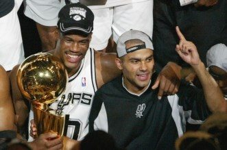 David Robinson (L) of the San Antonio Spurs and Frenchman Tony Parker celebrate after beating the New Jersey Nets in game six of the NBA Finals at SBC Center in San Antonio, Texas. The Spurs won the game 88-77 to win the best-of-seven game series 4-2.   AFP PHOTO/James NIELSEN  (Photo credit should read JAMES NIELSEN/AFP/Getty Images)