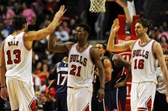 Oct 16, 2014; Chicago, IL, USA; Chicago Bulls guard Jimmy Butler (21) gets high-fives from Chicago Bulls center Joakim Noah (13) and Chicago Bulls forward Pau Gasol (16) after being fouled by the an Atlanta Hawks player during the second half at the United Center. The Chicago Bulls defeated the Atlanta Hawks 85-84. Mandatory Credit: Matt Marton-USA TODAY Sports