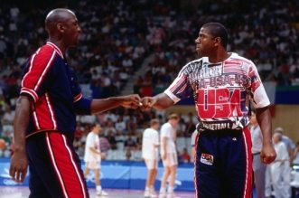 BARCELONA, SPAIN- AUGUST 6: Magic Johnson and Michael Jordan of the United States high five each other against Lithuania during the 1992 Olympics on August 6, 1992 at the Palau Municipal d'Esports de badalona in Barcelona, Spain. The United States defeated Lithuania 127-76. NOTE TO USER: User expressly acknowledges and agrees that, by downloading and or using this photograph, User is consenting to the terms and conditions of the Getty Images License Agreement. Mandatory Copyright Notice: Copyright 1992 NBAE (Photo by Andrew D. Bernstein/NBAE via Getty Images)