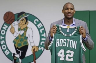 Boston Celtics forward Al Horford holds up a jersey during a media availability at the team's practice facility, Friday, July 8, 2016, in Waltham, Mass. Horford agreed to a four-year, $113 million deal with the Celtics as an unrestricted free agent, ending nearly ten years with the Atlanta Hawks. (AP Photo/Charles Krupa)