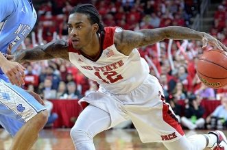 RALEIGH, NC - JANUARY 14:  Anthony Barber #12 of the North Carolina State Wolfpack drives against Marcus Paige #5 of the North Carolina Tar Heels during their game at PNC Arena on January 14, 2015 in Raleigh, North Carolina.  (Photo by Grant Halverson/Getty Images)