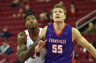 December 20 2015: Evansville Purple Aces center Egidijus Mockevicius (55) attempts to block out Fresno State Bulldogs forward Torren Jones (24) goes up for the shot during the Fresno State Bulldogs vs the Evansville Purple Aces NCAA basketball game.  The Purple Aces defeated the Bulldogs 85 - 77 at the Save Mart Center in Fresno Ca.