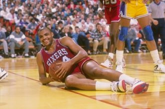 1988-1989:  Forward Charles Barkley of the Philadelphia 76ers lies on the court with the ball during a game against the Los Angeles Lakers at the Great Western Forum in Inglewood, California. Mandatory Credit: Stephen Dunn  /Allsport