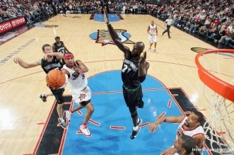 PHILADELPHIA - DECEMBER 3:  Allen Iverson #3 of the Philadelphia 76ers goes to the hoop past Kevin Garnett #21 of the Minnesota Timberwolves on December 3, 2006 at the Wachovia Center in Philadelphia, Pennsylvania. The Wolves won 95-84. NOTE TO USER: User expressly acknowledges and agrees that, by downloading and or using this Photograph, user is consenting to the terms and conditions of the Getty Images License Agreement. Mandatory Copyright Notice: Copyright 2006 NBAE (Photo by Jesse D. Garrabrant/NBAE via Getty Images)