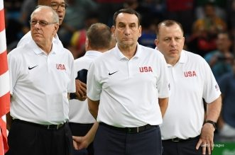 RIO DE JANEIRO, BRAZIL - AUGUST 8:  Head coach Mike Krzyzewski of the USA Basketball Men's National Team and his coaching staff look on before the game against Venezuela on Day 3 of the Rio 2016 Olympic Games at Carioca Arena 1 on August 8, 2016 in Rio de Janeiro, Brazil. NOTE TO USER: User expressly acknowledges and agrees that, by downloading and/or using this Photograph, user is consenting to the terms and conditions of the Getty Images License Agreement. Mandatory Copyright Notice: Copyright 2016 NBAE (Photo by Garrett Ellwood/NBAE via Getty Images)