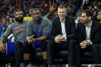Apr 8, 2016; Philadelphia, PA, USA; From left to right, New York Knicks forward Kyle O'Quinn (9) and center Kevin Seraphin (1) and forward Kristaps Porzingis (6) and guard Jose Calderon (3) joke around on the bench during a game against the Philadelphia 76ers at Wells Fargo Center. The New York Knicks won 109-102. Mandatory Credit: Bill Streicher-USA TODAY Sports