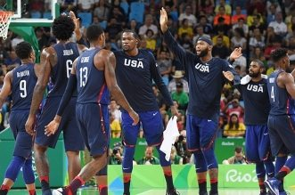 RIO DE JANEIRO, BRAZIL - AUGUST 6:  The USA Basketball Men's National Team celebrates during the game against China on Day 1 of the Rio 2016 Olympic Games at Carioca Arena 1 on August 6, 2016 in Rio de Janeiro, Brazil. NOTE TO USER: User expressly acknowledges and agrees that, by downloading and/or using this Photograph, user is consenting to the terms and conditions of the Getty Images License Agreement. Mandatory Copyright Notice: Copyright 2016 NBAE (Photo by Garrett Ellwood/NBAE via Getty Images)