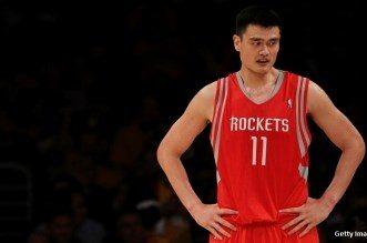 LOS ANGELES, CA - OCTOBER 26:  Yao Ming #11 of the Houston Rockets looks on during their opening night game against the Los Angeles Lakers at Staples Center on October 26, 2010 in Los Angeles, California. NOTE TO USER: User expressly acknowledges and agrees that, by downloading and or using this photograph, User is consenting to the terms and conditions of the Getty Images License Agreement.  (Photo by Jeff Gross/Getty Images)