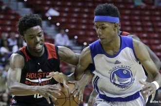 Golden State Warriors' Patrick McCaw, right, and Houston Rockets' Isaiah Taylor battle for the ball during the second half of an NBA summer league basketball game, Wednesday, July 13, 2016, in Las Vegas. (AP Photo/John Locher)