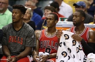 Oct 6, 2016; Indianapolis, IN, USA; (From R-L) Chicago Bulls Jimmy Butler, Rajon Rondo, and Dwayne Wade watch from the bench during their game against the Indiana Pacers at Bankers Life Fieldhouse. The Pacers won 115-108. Mandatory Credit: Brian Spurlock-USA TODAY Sports