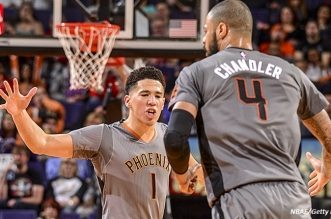 PHOENIX, AZ - JANUARY 21:  Devin Booker #1 of the Phoenix Suns celebrates with Tyson Chandler #4 of the Phoenix Suns during the game against the San Antonio Spurs on January 21, 2016 at Talking Stick Resort Arena in Phoenix, Arizona. NOTE TO USER: User expressly acknowledges and agrees that, by downloading and or using this photograph, user is consenting to the terms and conditions of the Getty Images License Agreement. Mandatory Copyright Notice: Copyright 2016 NBAE (Photo by Barry Gossage/NBAE via Getty Images)