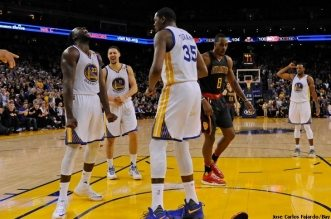 Golden State Warriors' Draymond Green (23) reacts after blocking a shot attempt by Atlanta Hawks' Dennis Schroder (17) in the final seconds of the fourth quarter of their NBA game at the Oracle Arena in Oakland, Calif. on Monday, Nov. 28, 2016. Golden State defeated the Hawks 105-100. (Jose Carlos Fajardo/Bay Area News Group)